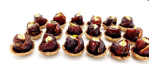 Dates, sesame, tahini paste, pistachio, dark chocolate